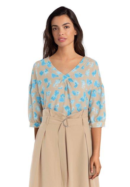 Beige blouse met blauwe vlekken en V-hals