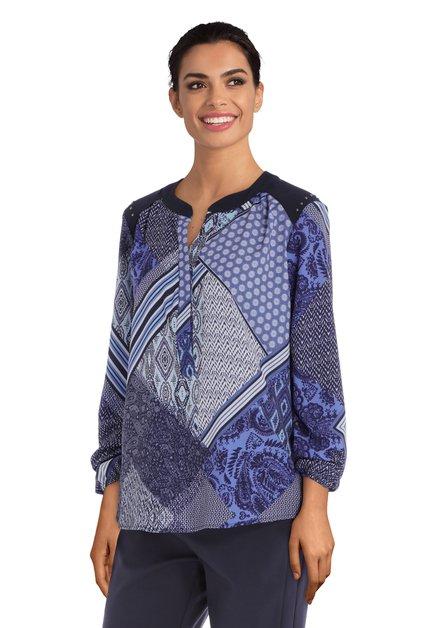 Blauwe blouse met eclectische print