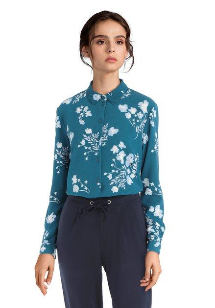 Blauwe blouse met een bloemenmotief