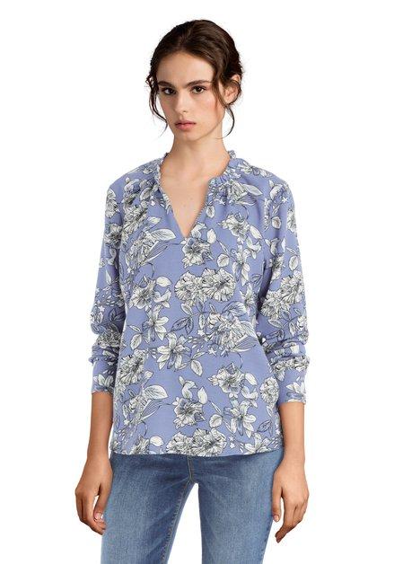 Blauwe blouse met witte bloemen