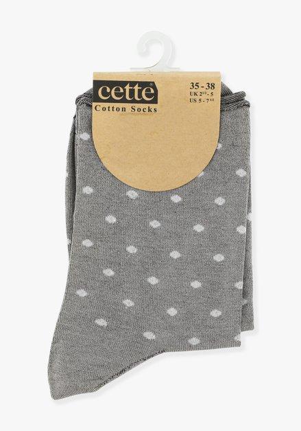 Chaussettes grises à pois blancs
