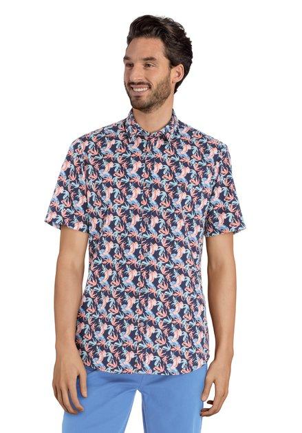 Chemise bleue avec imprimé à feuilles