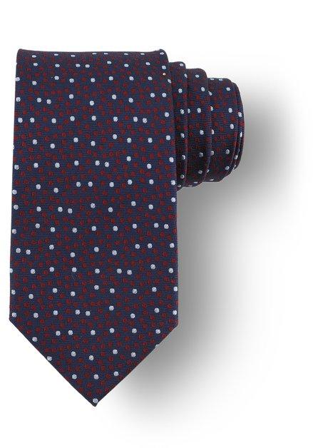 Cravate bleu foncé à pois rouges