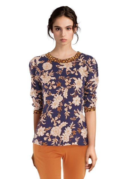 Donkerblauwe blouse met ecru bloemen