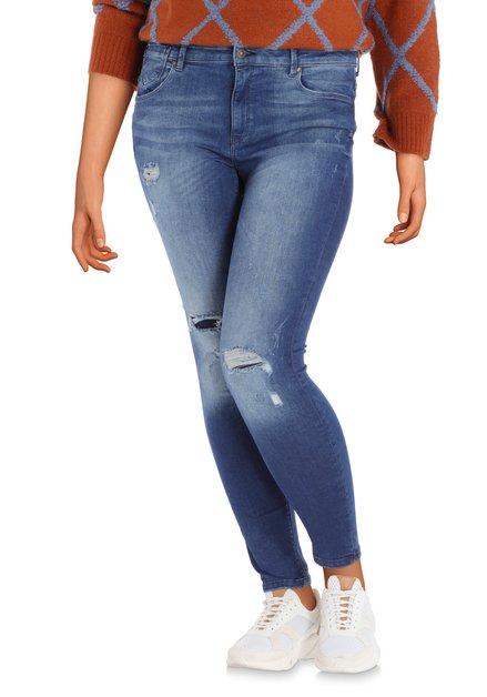 Donkerblauwe ripped jeans met wassing - skinny fit
