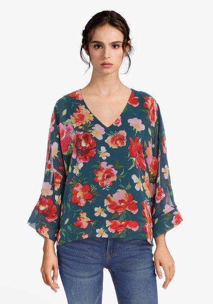 Donkergroene blouse met felroze bloemen