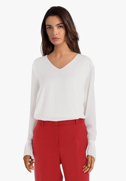 Ecru blouse met trompetmouwen
