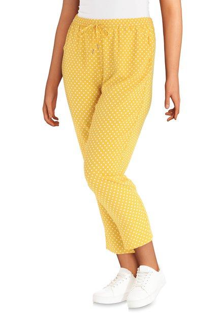 Gele broek met witte stippen