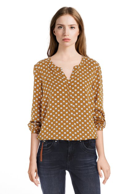 Goudkleurige blouse met ecru blokjes