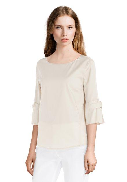 Lichtbeige blouse met knoop aan de mouwen