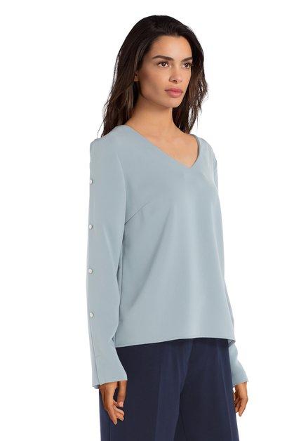 Lichtblauwe blouse met zilverkleurige knopen