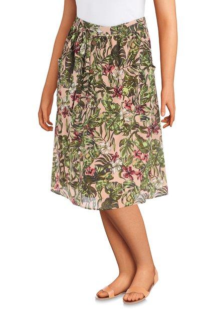 Lichtroze rok met groene bladerprint en bloemen