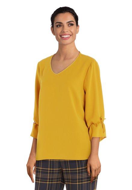 Mosterdgele blouse met V-hals
