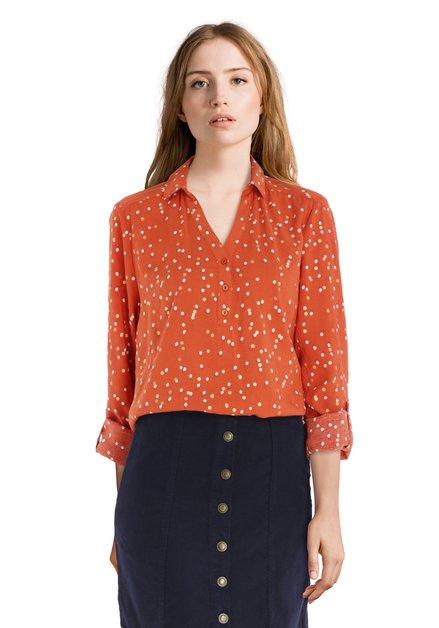Oranje blouse met goudkleurige bolletjes