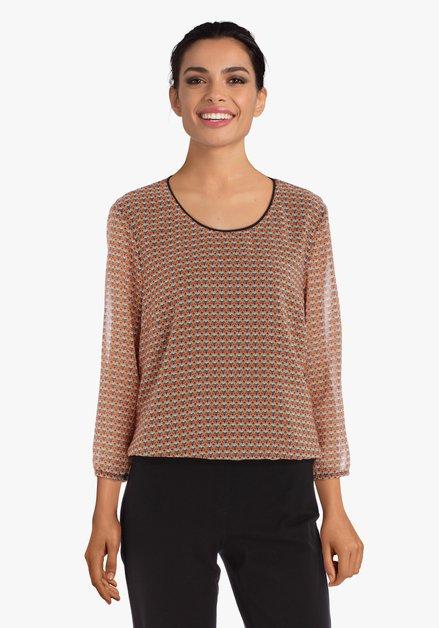 Oranje blouse met retroprint