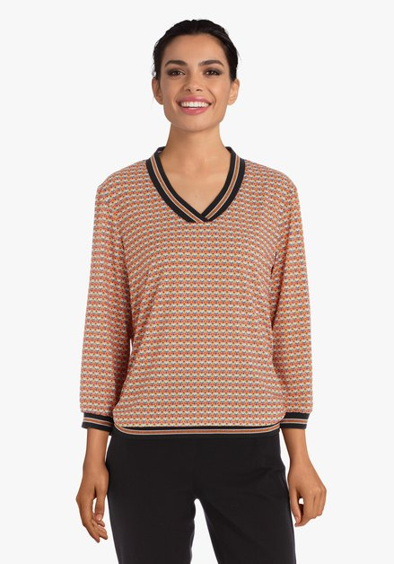 Oranje blouse met retroprint en V-hals