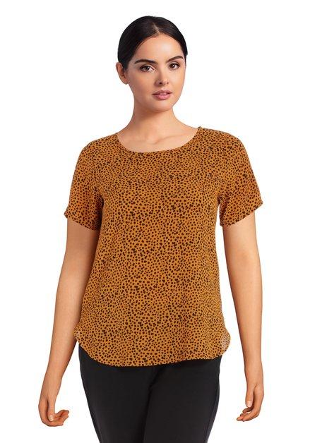 Oranje blouse met zwarte stippen
