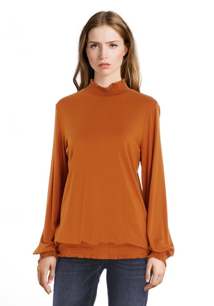 Oranjebruine blouse met smokwerk