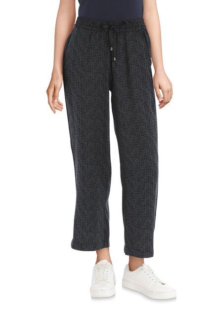 Pantalon 7/8 en lin noir avec imprimé