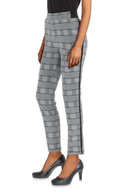 Pantalon à carreaux blanc-noir avec galon noir