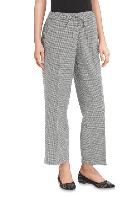 Pantalon à carreaux en noir et blanc