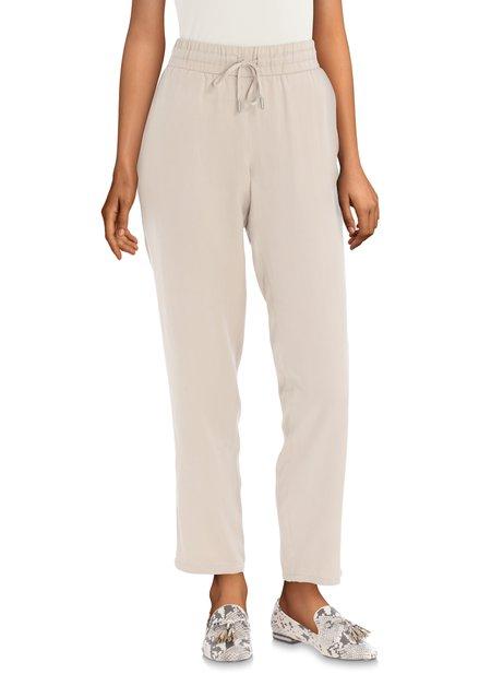Pantalon beige à galon blanc