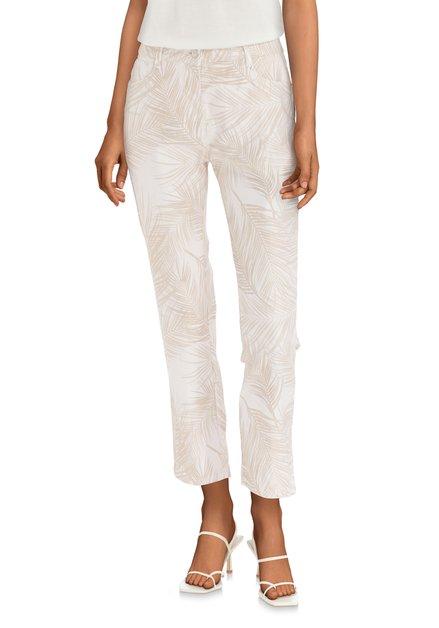 Pantalon beige à imprimé à feuilles