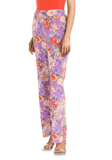 Pantalon mauve avec imprimé floral coloré
