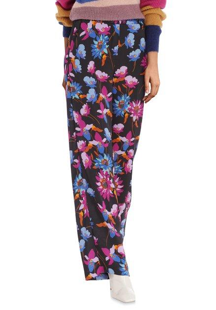 Pantalon noir avec imprimé floral exotique