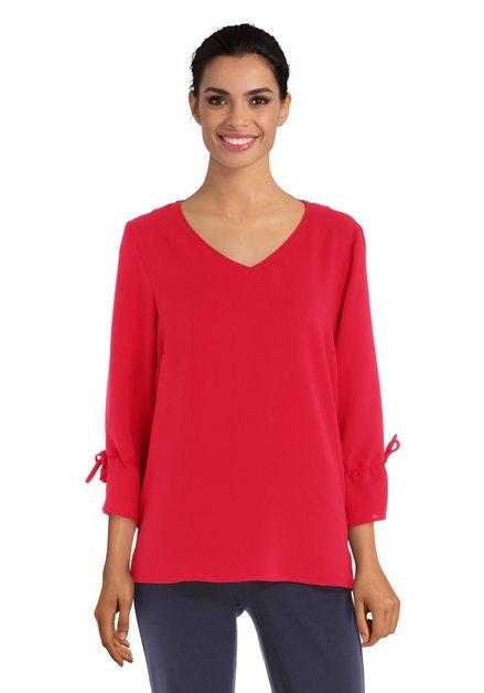 Rode blouse met v-hals