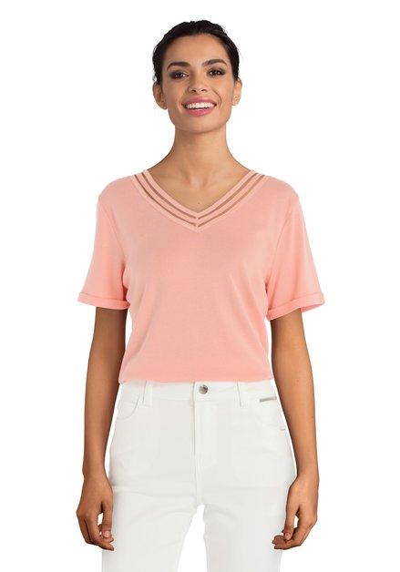 Roze T-shirt met uitsnijdingen en strass