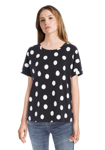 T-shirt bleu foncé avec des pois blancs