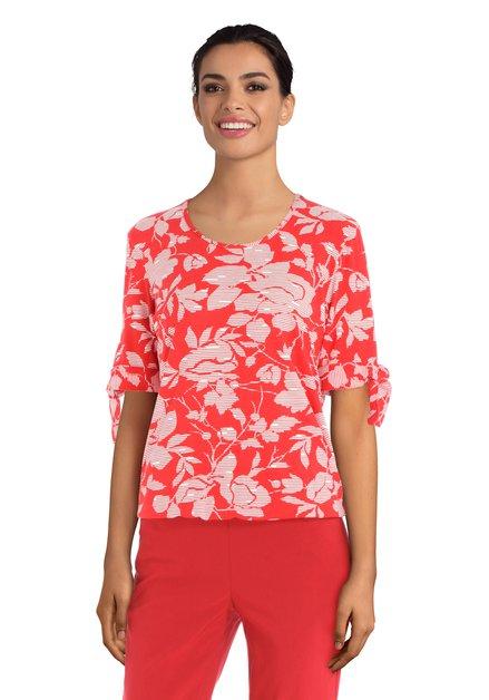 T-shirt rouge à fleurs blanches