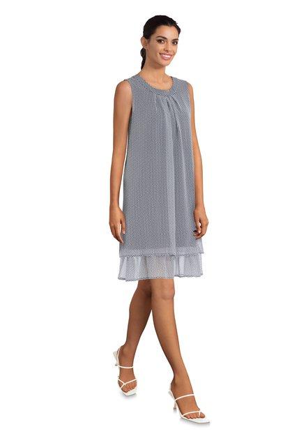 Wit kleed met blauwe miniprint in voilestof