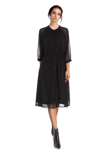Zwart kleed in structuurstof