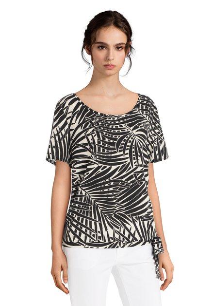 Zwart-wit T-shirt met bladerprint en knoop