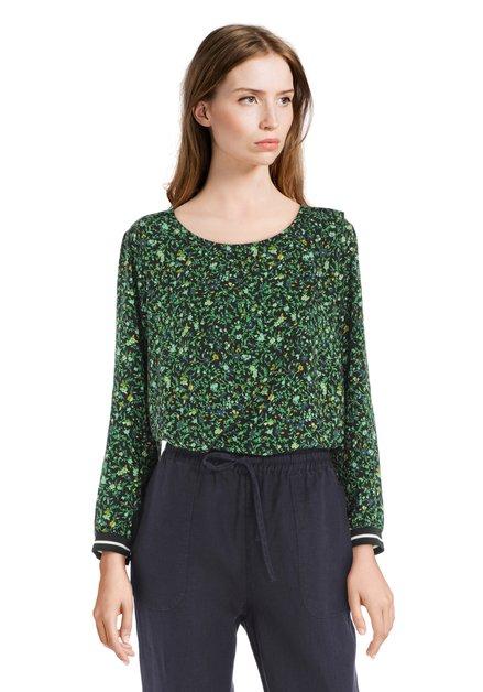 Zwarte blouse met groene blaadjes en gele bloemen