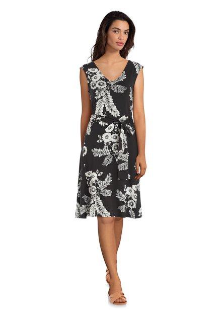 2bf132b1107951 Zwarte jurk met witte bloemenprint