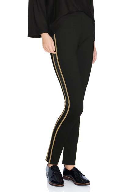 Zwarte legging met goudkleurig biesje