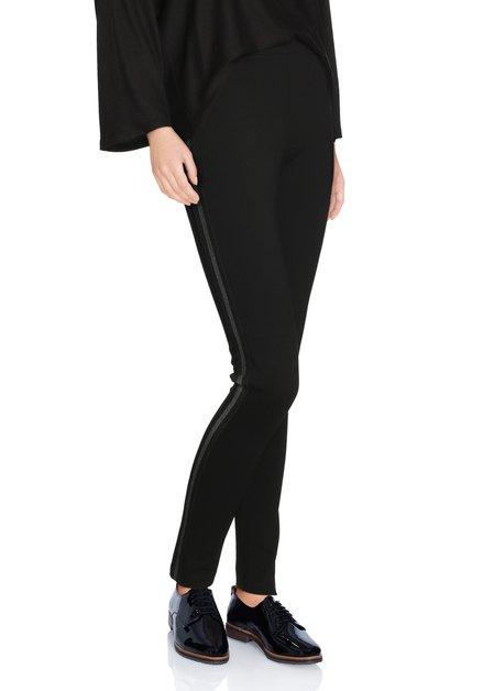 Zwarte legging met zilverkleurig biesje