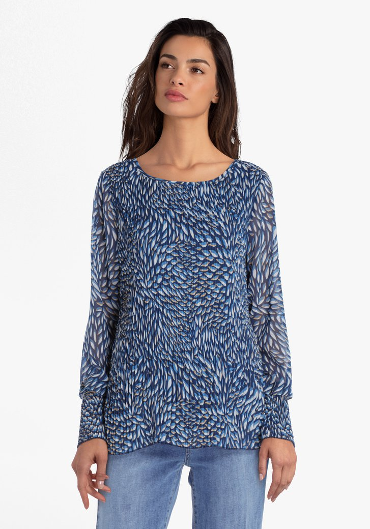 Blauwe blouse in plissé stof