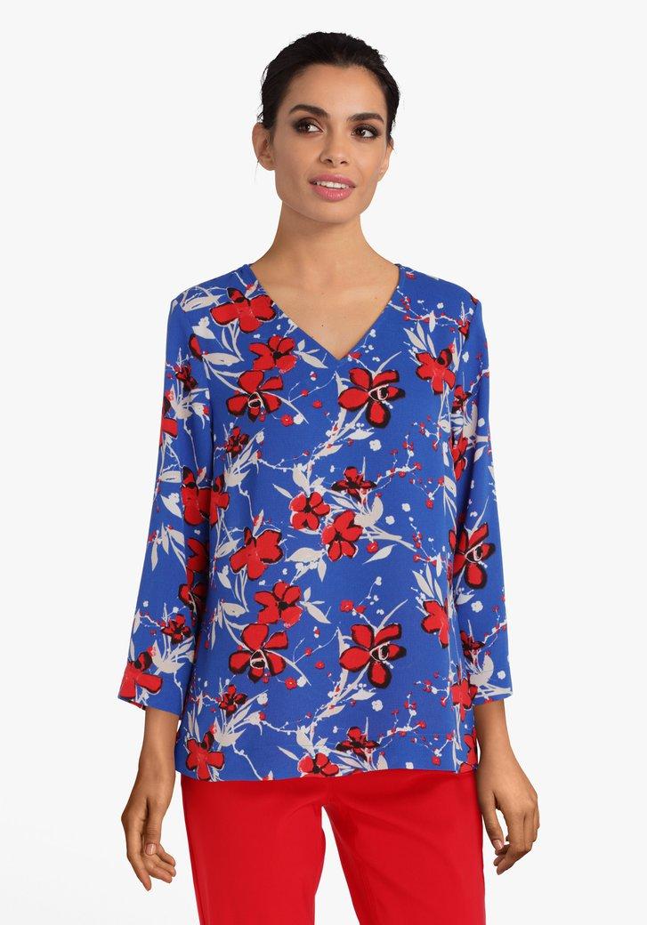 Afbeelding van Blauwe blouse met rode bloemen