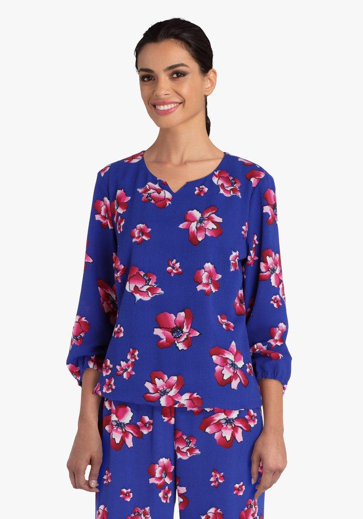 Blauwe blouse met roze bloemen