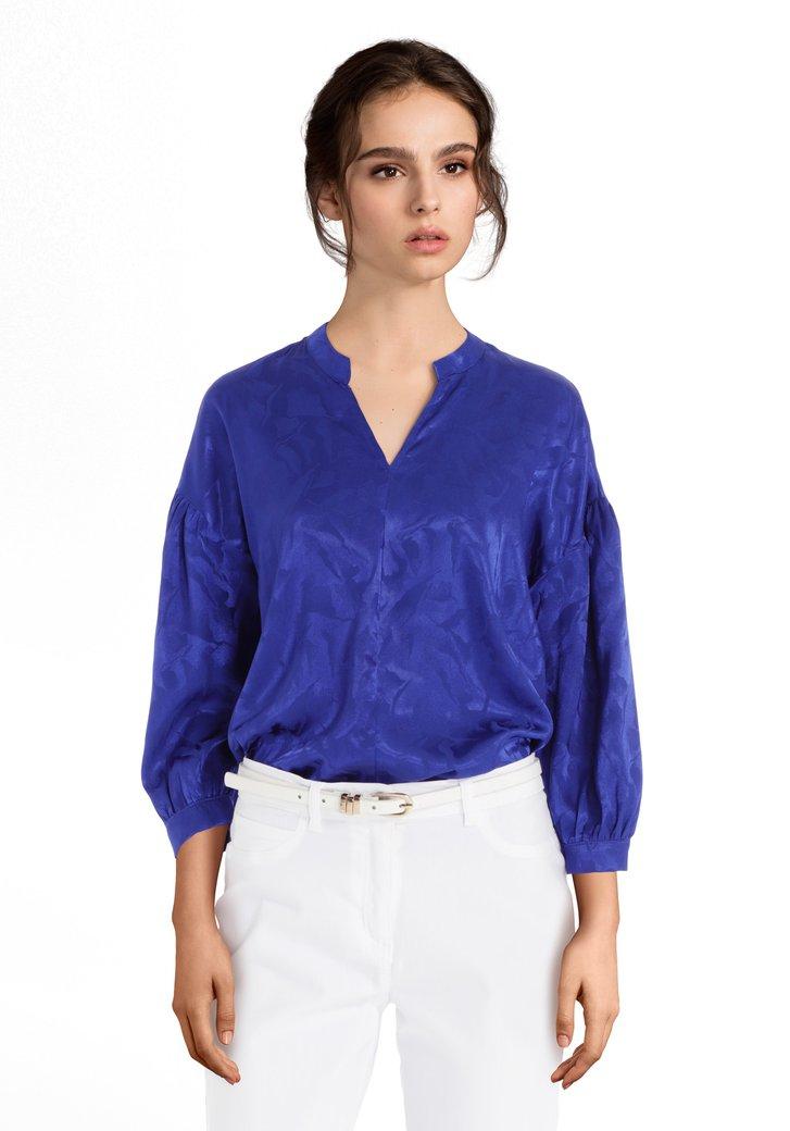 Afbeelding van Blauwe blouse met toon-op-toon motief