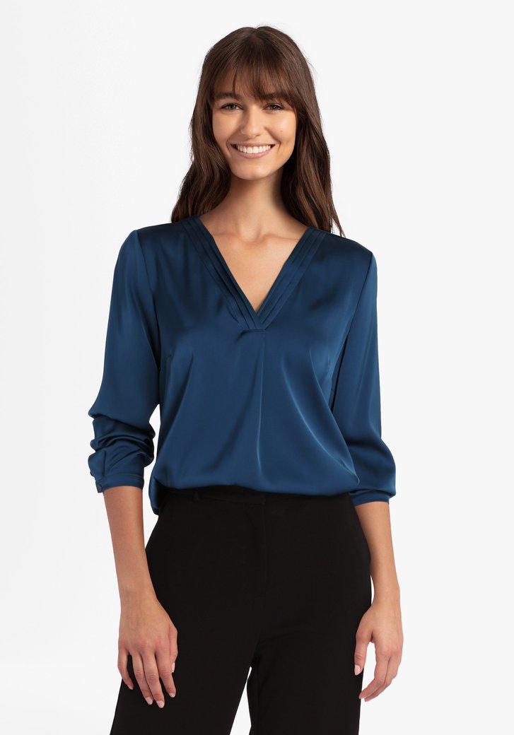Blauwe blouse met V-hals