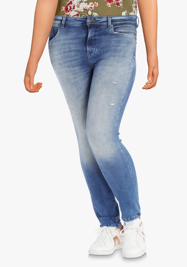 Blauwe jeans met slijtagedetails – slim fit