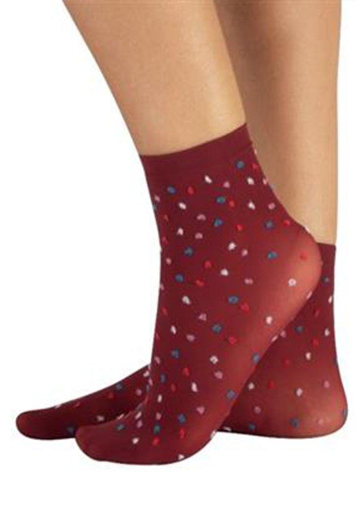Blauwe sokjes met gekleurde stipjes