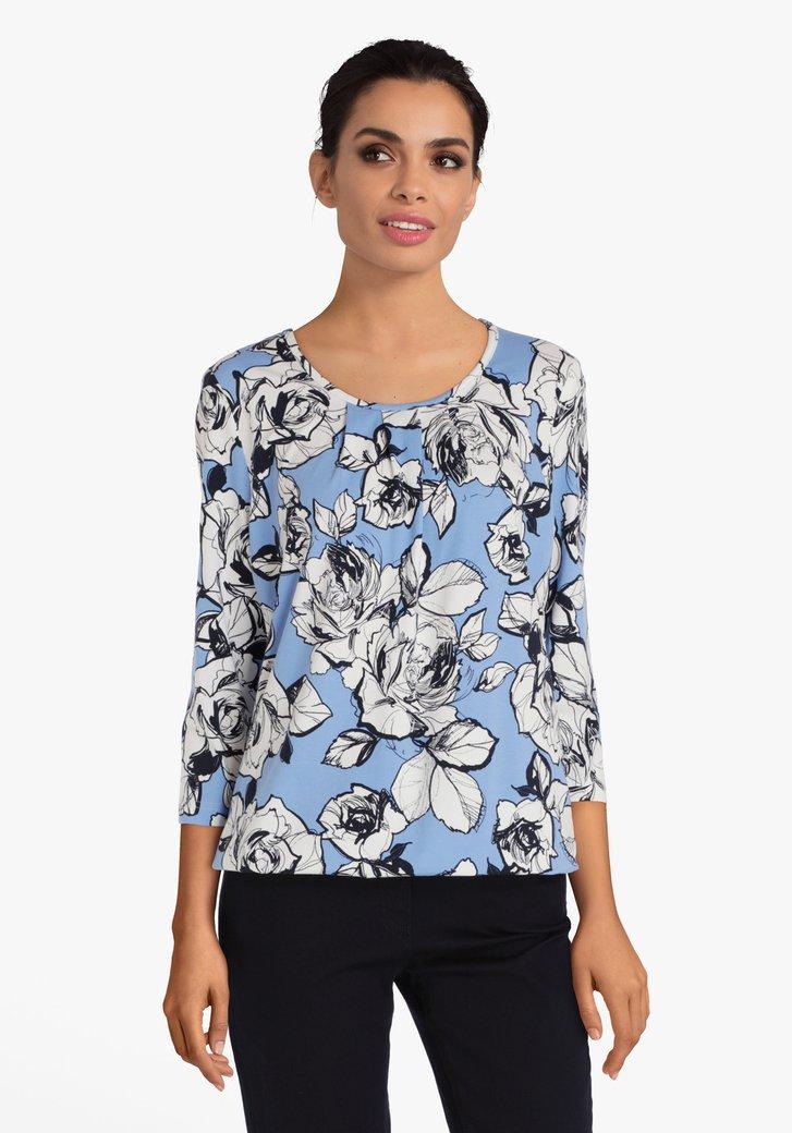 Blauwe T-shirt met witte bloemen