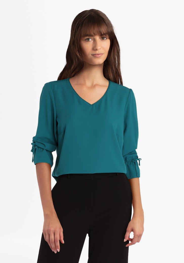 Blauwgroene blouse met strikjes