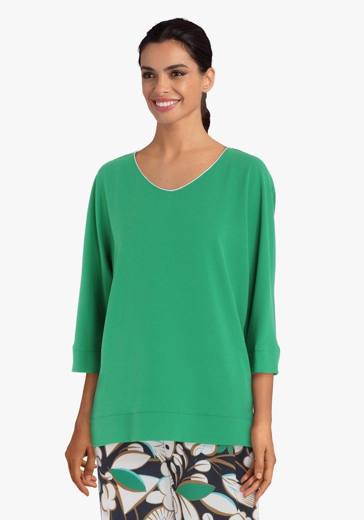 Blouse verte avec bordure argentée